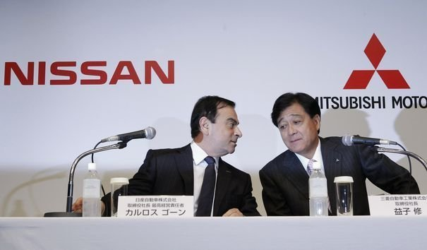 Nissan Motor Chief Executive Ghosn and Mitsubishi Motors Corp President Masuko arrive at their joint news conference in Tokyo